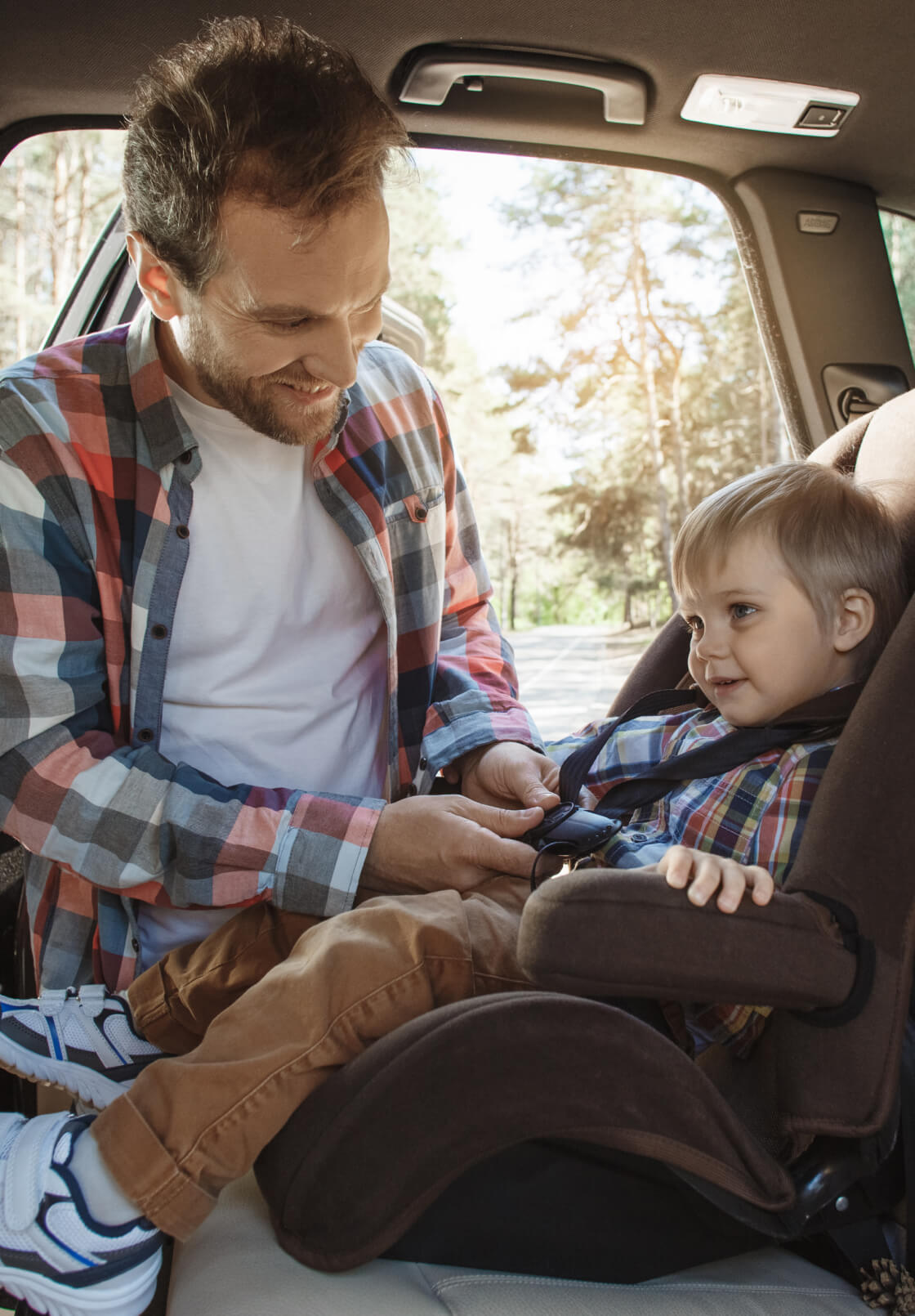 Dad Strapping Car Seat