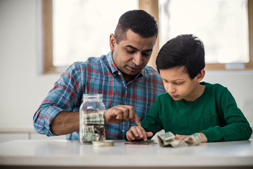a father teaching his son about money